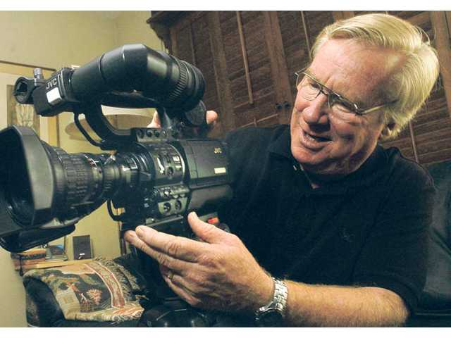 Michael McGreevey, of Valencia, displays one of his documentary video cameras. After a career as a child star, McGreevey worked as a writer and a documentary filmmaker.