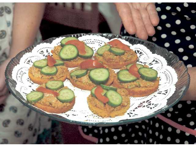 Andouille chicken sausage open-faced tea sandwiches are impressive, yet easy to make.