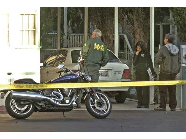 "Los Angeles County Sheriff's Department crime-lab investigators examine the scene of an officer-involved shooting at the Parklane Mobile Estates mobile-home park in Canyon Country on Friday. An investigator said Ralph Noriega took ""a shooting stance"" before being fired upon by deputies."