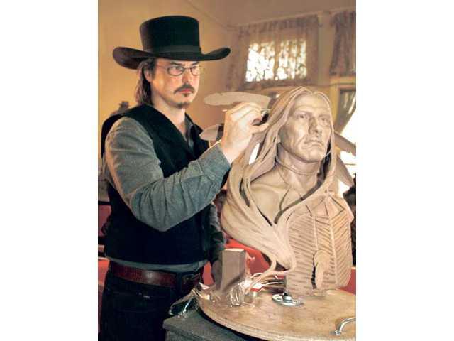 Saugus sculptor Greg Polutanovich demonstrated his art at the Santa Clarita Cowboy Festival.