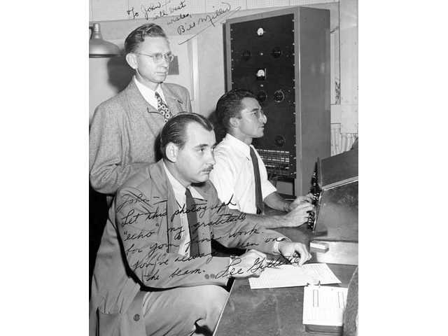 John Palladino, right, engineers a session at Radio Recorders in Hollywood in the mid-1940s, as colleagues Bill Miller, standing, and Lee Gillette observe.