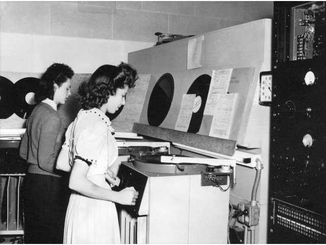 At Radio Recorders in Hollywood during World War II, sound engineers Evelyn Blanchard, left (soon to be Evelyn Palladino) and Rose Palladino prepare acetate discs of radio shows to be sent to armed forces overseas.