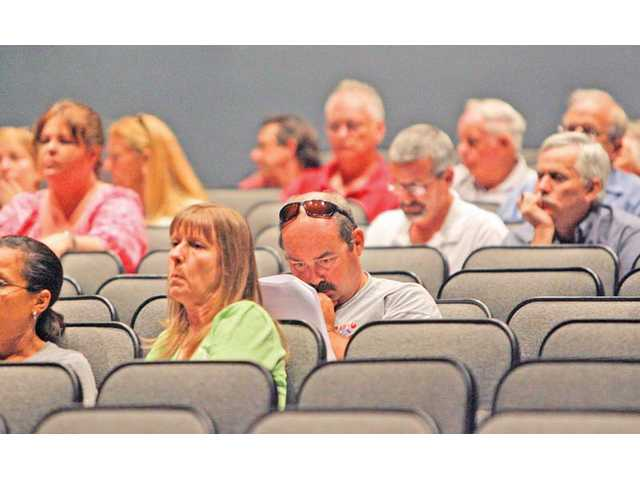 Castaic residents in attendance for William S. Hart Union High School District's board meeting Wednesday, which was held in Golden Valley High School's theater, listen as school officials, consultants and members of the community debate two potential sites for a Castaic high school.