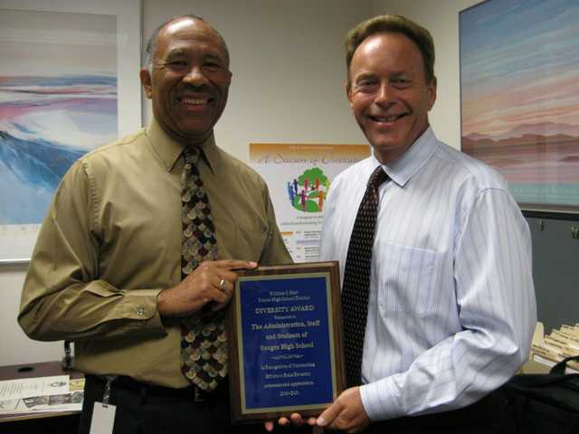 Saugus High School won this year's Valuing Diversity Award, which was presented to Principal Bill Bolde.