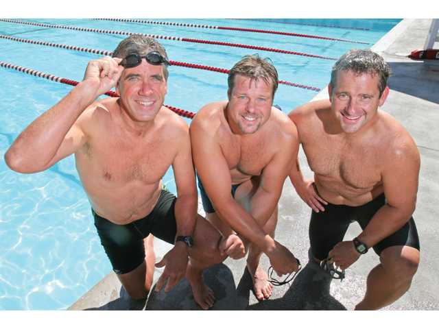 (From left to right) Local swimmers David Hartmire, Chris Dahowski and Mike Vovk will team with Cal State Fullerton graduate student Jen Schumacher in attempting the first-ever relay swim to Catalina Island and back in October.