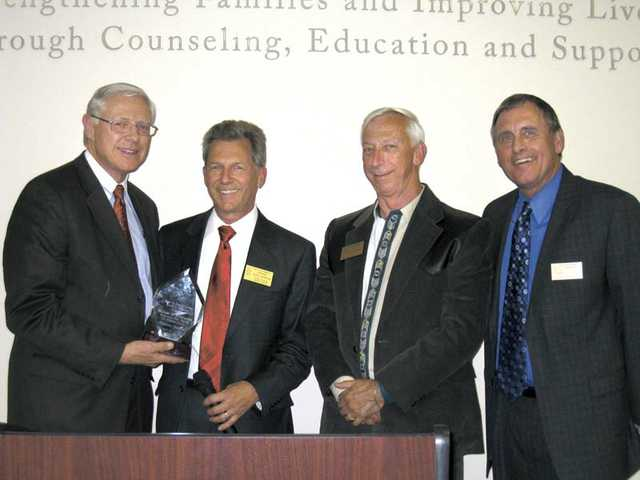 Michael D. Antonovich, Los Angeles County supervisor, left, is named an honorary director of the Child & Family Center by, left to right, Terry Martin, past board chairman, John Hoskinson, incoming board chairman, and Darrel Paulk, CEO of the Center.