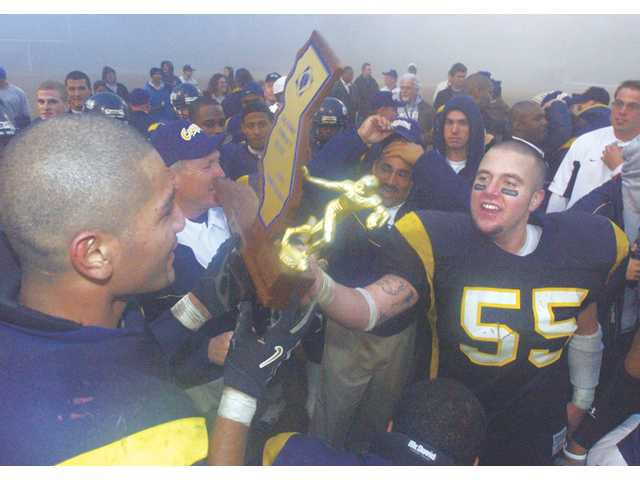 The College of the Canyons football team celebrates its California State Championship after beating the City College of San Francisco 39-32 on Dec. 11, 2004. The Cougars were eventually named the national champions by JC Gridwire.