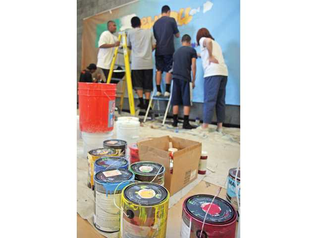 Local teens, ages 15 to 17, developed and created a mural depicting the past and present of Newhall. Working with the Santa Clarita Valley Community Center and The ARTree, the teens have been developing this project for about a month.
