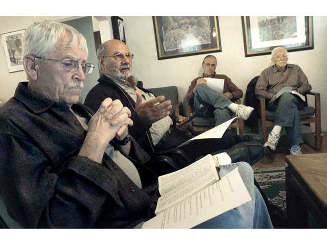 From left, Jack Beaver, Ted Vartanian, John Ihms and Harold Donnelly attend a Bible study in the Barnabas House living room. The Barnabas House considers itself a Christian resource center that features Bible studies, gathering activities, counseling and personal discipleship.