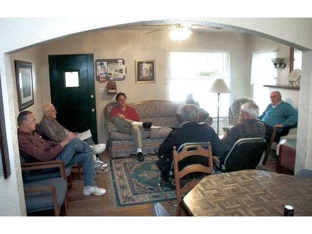 Art Dolder, far right, leads the Bible study group in the living room of the Barnabas House. Dolder started the Ministries of Encouragement 13 years ago, and bought the house a few years after that.