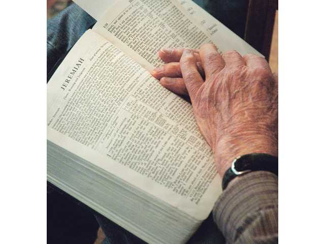 Harold Donnelly has his Bible open to the book of Jeremiah.