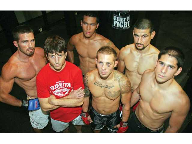 (Clockwise from left) Mixed martial artists David Webber, Donovan Santana, Vinc Pichel, Ruben Almanza, Trevor Harris and coach Brian Peterson make up some of the faces of Big John McCarthy's Ultimate Training Academy in Valencia.