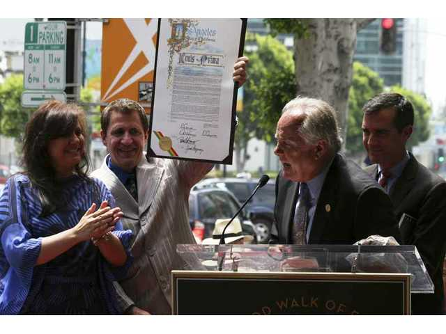 "Sunday, July 25, 2010 was ""Louis Prima Day"" in Hollywood and the city of Los Angeles, and (from left) the late bandleader's daughter, Lena Prima, and son, Louis Prima Jr., accepted an official proclamation presented by L.A. City Councilmen Tom LaBonge and Eric Garcetti, just before Prima Sr.'s star on the Hollywood Walk of Fame was dedicated."