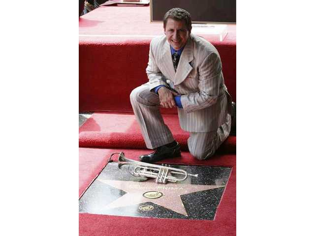 Trumpeter/bandleader Louis Prima Jr. posed after the unveiling of a star on the Hollywood Walk of Fame honoring his father, swing-jump-jazz giant Louis Prima, on Sunday.