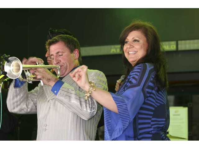 "Trumpeter/bandleader Louis Prima Jr. and his sister, Lena Prima, closed their live performance with ""When the Saints Go Marching In"" Sunday after the unveiling of a star on the Hollywood Walk of Fame honoring the Primas' father, Louis Prima."