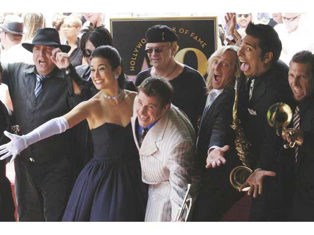 Louis Prima Jr. (center), singer Sarah Spiegel and the other members of Prima Jr.'s band The Witnesses wowed the crowd with a special performance after Sunday's dedication of Louis Prima Sr.'s star on the Hollywood Walk of Fame.