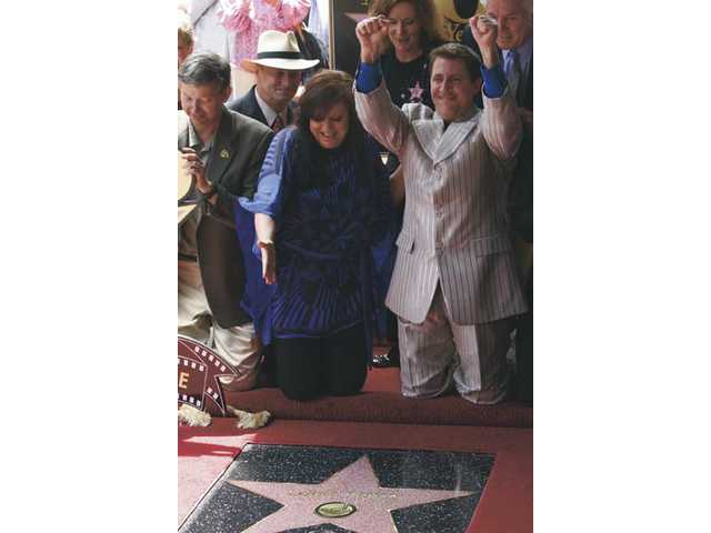 Louis Prima Jr. and his sister Lena Prima, center, celebrate the unveiling of a star on the Hollywood Walk of Fame for their late father, Louis Prima. Joining them are (from left) Leron Gubler, emcee and Hollywood Chamber of Commerce president/CEO; Sam Smith, Hollywood Chamber chairman; Karen  Diehl, Walk of Fame 50th chairwoman; and Tom LaBonge, L.A. City Councilman.