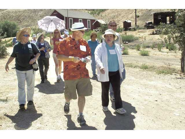 Historian E.J. Stephens, center, leads a tour at the historic oil boom town of Mentryville as part of the Newhallywood on Location history class in Santa Clarita on Saturday. The last course will take place Saturday from 1-4 p.m.