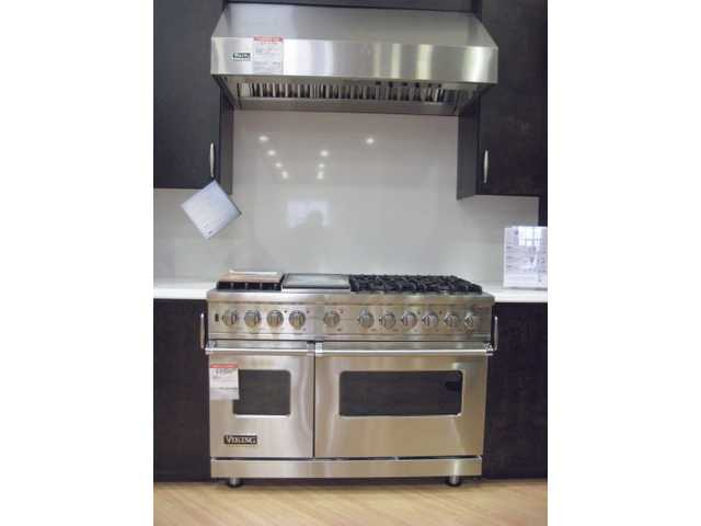 This Viking professional range, priced at $9,899 at Pacific Sales in Valencia, has sealed burners. You can order the stove with six or eight burners. In addition, this stove includes a separate companion oven that allows cooking at a different temperature. Add a separate Viking hood for $1,799. The hood includes halogen  lights and heat lamps.