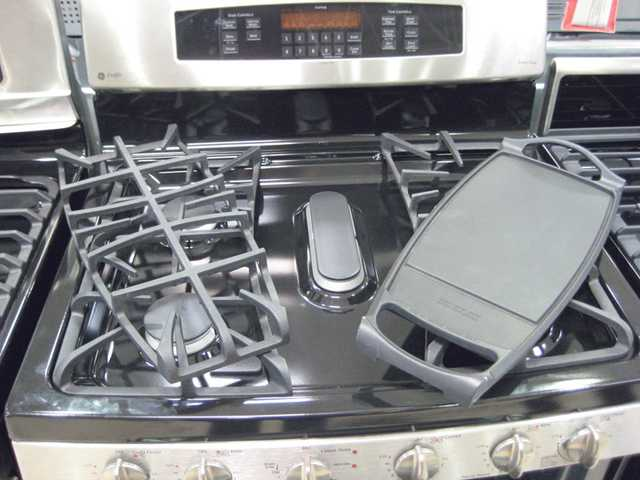 The center burner on this range can be used with a grill or griddle.