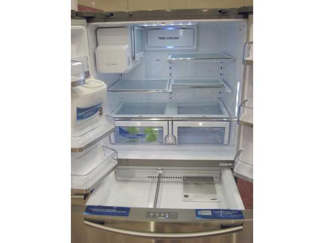 This the top-of-the-line Samsung refrigerator costs $2,999, and includes French doors and a large freezer below — in stainless steel, of course. Note the large temperature-controlled drawers at the bottom. Samsung is also offering a 20-percent rebate. This is one of the largest French-door refrigerators available. The freezer includes vertical pizza-storage slots.