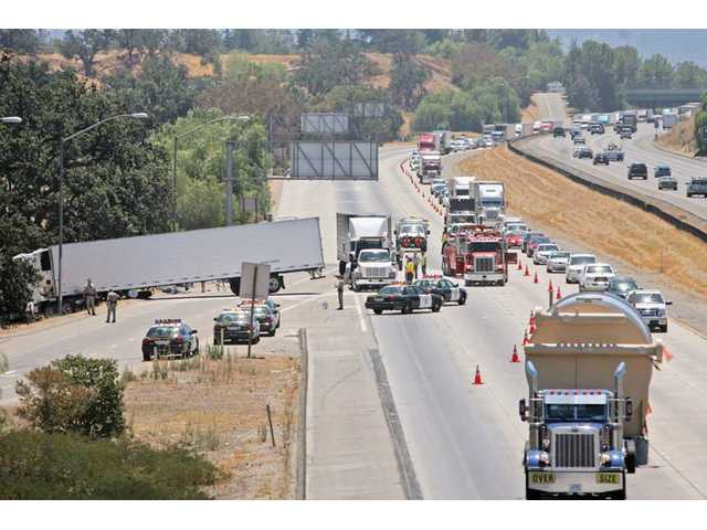 An injury crash involving two semi-trailer trucks and a car sent the car's driver to a local trauma center and backed up northbound traffic on Interstate 5 near the Valencia Boulevard exit for several hours on Friday.