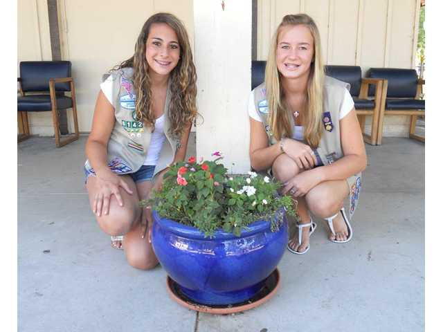 Girl Scouts Caren Rosen, a freshman from Saugus High School, and Carissa Costanzo, a freshman from William S. Hart High School.