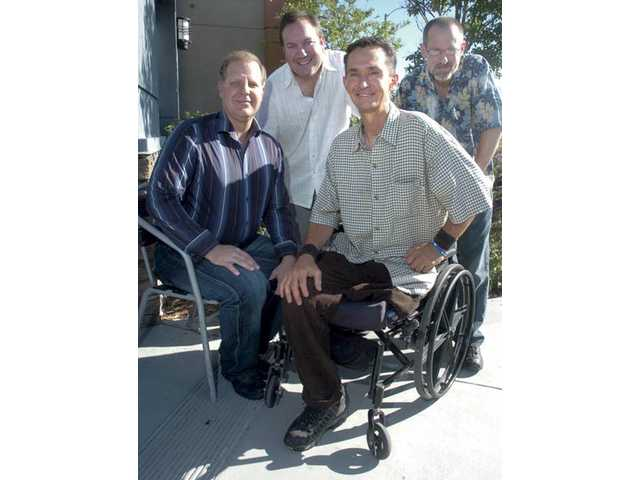 From left, documentary producer Kurt Fethke, director Eric Clarke, Flying Mike Brown and writer Marlowe Weisman.