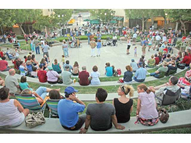 """Local residents dance to the tunes of the Rick Michael Quartet at the Valencia Marketplace's amphitheater in Stevenson Ranch on Friday evening.  Michael played music he described as """"a lot of nostalgia"""" to the all-ages crowd. The series will run for two more weeks from 6-8 p.m. on Friday."""