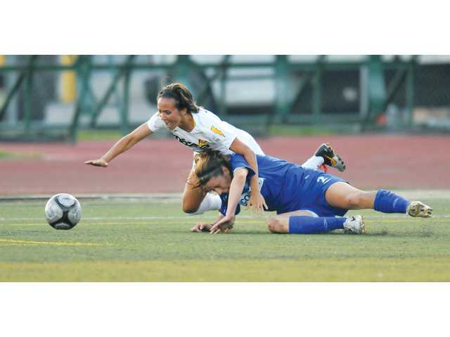 Vancouver Whitecaps defender Emily Zurrer (bottom) collides with Buffalo Flash midfielder Mele French during the championship game of the United States Soccer Leagues W-League on Saturday at Harry Welch Stadium in Canyon Country. The Flash rallied to win 3-1.
