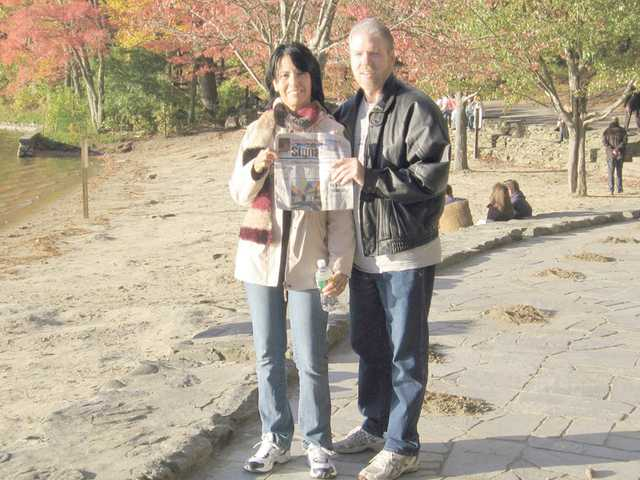 Diane McMann and her husband, John Gillott, pose near Walden Pond in Concord, Mass., as part of a six-day trip to Boston in October.