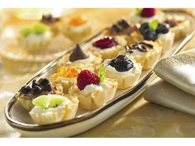 Creamy mini tarts are a snap to assemble using already prepared phyllo shells and a filling that includes cream cheese, lemon juice and condensed milk.