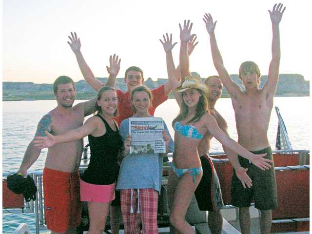 From left, Matt Davis, Danielle Sherman, Daniel McGowan, Rachel McGowan, Kelly Spurling, Andrew Sherman and Eddie Spurling pose on their annual houseboat trip in Lake Powell Arizona. The three families were on their 7th trip.