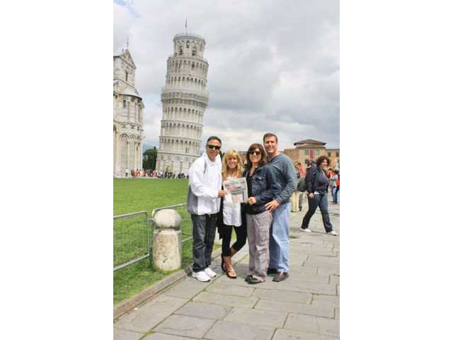 From left, Chris Fall, Jayne Fall, Vanessa Wilk and Scott Wilk pose in front of the Leaning Tower of Pisa in  Italy.