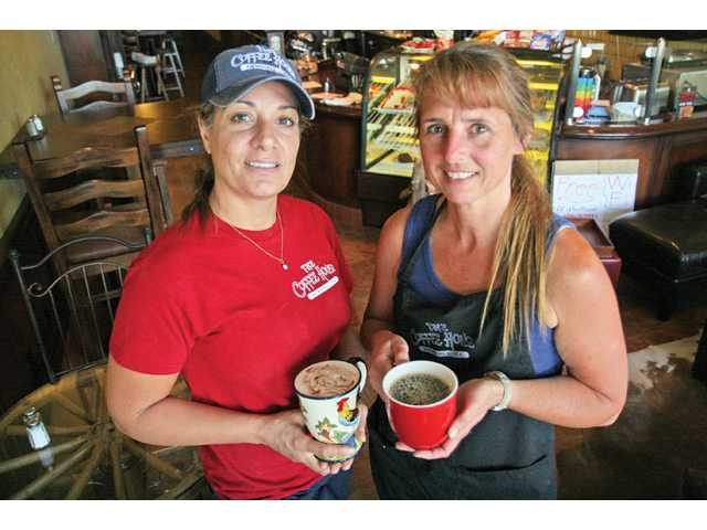 Diana Zahreddine, left, and Chris David, both of Newhall, are the new owners of The Coffee House, located at the corner of Lyons Avenue and Apple Street.