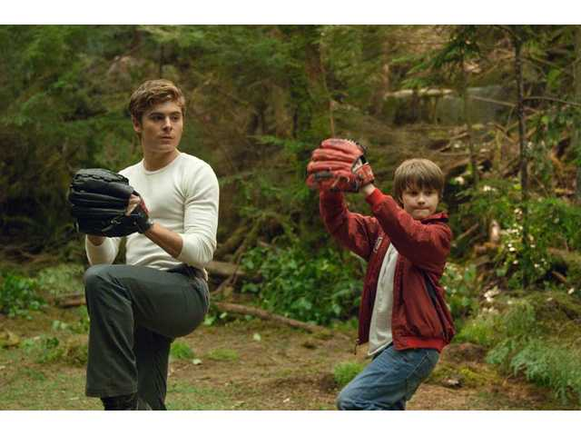 "Charlie Tahan, right, and Zac Efron are shown in a scene from  ""Charlie St. Cloud,"" which opened last week."