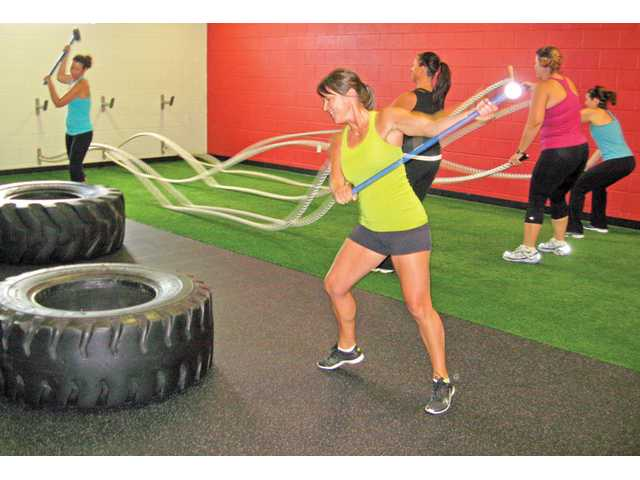 Women work out at Results Fitness in Newhall. Now that school is almost back in session it is time to return to the gym, too. Find the time to take care of yourself.