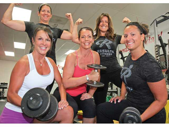 Clockwise from top left, Santa Clarita Valley mothers Cheryl Clift, Ruth Stanke, Renee Austin, Cyndi Madia and Nina Conner proudly display their muscles during a workout session at Results Fitness in Newhall.