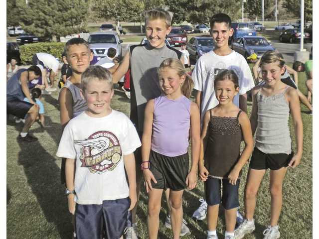 Some of the Santa Clarita Storm Track Club's top youth runners are, front row, from left: Daniel Rush, Kaylee Schmidt, Adrianna Hill and Lauren Schenuk; back row: Jonathan Bay, Jonathan Summer and Cody Roelofson.