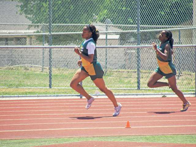 Asia Watts, left, won National Junior Olympic championships in the 100-meter dash and the 4x100 relay when she was younger, and the freshman-to-be hopes to return to similar heights as she begins her career with Canyon.