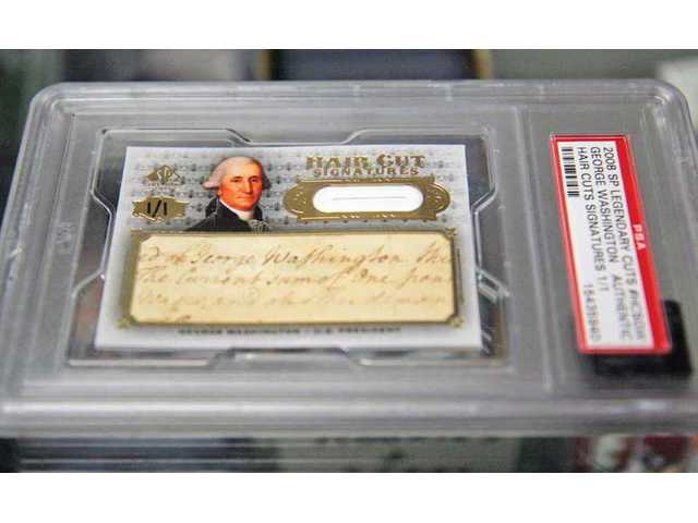 Valencia resident Jason Conn pulled this George Washington signature/haircut card from a pack at Card Connection.