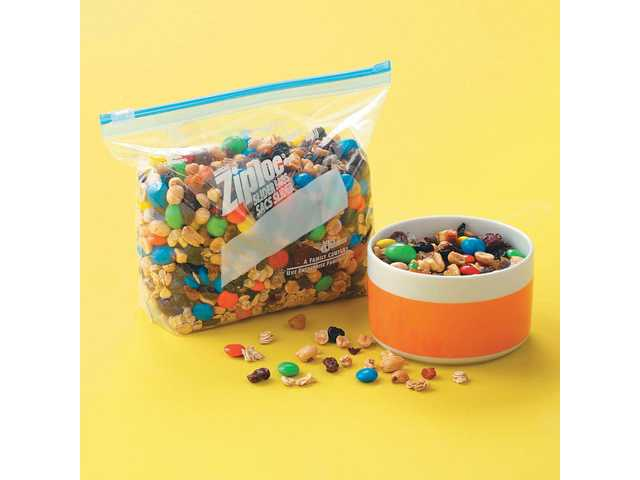 Motoring munchies: Packed with peanuts, dried fruit and other goodies, handfuls of this sweet snack will make kids happy on long car rides as well as at school!