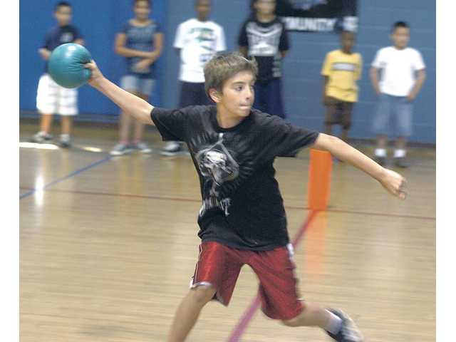 Bailey Prouty, 12, plays dodgeball at the Santa Clarita Boys & Girls Club in Newhall on Tuesday during the last days before school starts for him this week at Rancho Pico Junior High School.