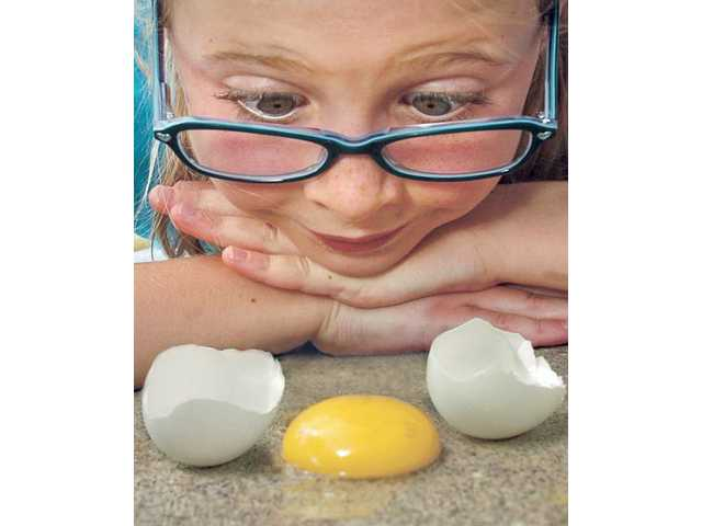 Riley Botton, 6, of Saugus, tries a cooking/weather experiment to find out if it's hot enough to fry an egg on the sidewalk. With the National Weather Service expecting triple-digit temperatures in the coming weeks, an unseasonably cool summer should soon heat up.