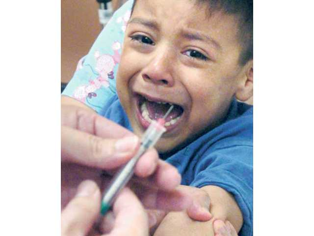 Vilmer Xujui, 4, of Saugus, cries as he anticipates an immunization shot in his arm Wednesday at Northeast Valley Health Corporation's Santa Clarita Health Center in Canyon County on Wednesday.