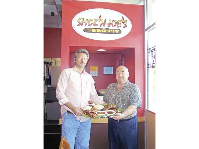 Paul Zimmerman and Gus Ravanis are co-owners of Smok'n Joe's BBQ Pit in Canyon Country.