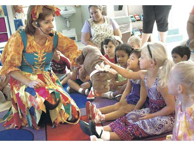 Wacky Wendee, left, introduces her puppet, Hilde Hippopotamus, to a group of preschoolers during her performance. Wacky Wendee will perform again at the Santa Clarita Little People Day Care and Pre-School at 17873 Sierra Highway in Canyon Country on Saturday at 10 a.m. The free performance is open to the public, and the first 20 people to RSVP at (661) 252-6308 will receive a free CD of Wacky Wendee's original songs.