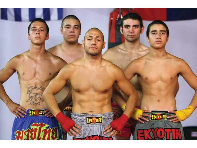 Five local fighters will participate in the World Muay Thai Council World Championships on Saturday at Saugus Speedway, the largest event of its kind in Santa Clarita Valley history. They are, front row, from left: Ruben Lahn, Hector Godoy and Vito Funicello. Back row, from left: Anthony Lahn, Francisco Funicello.