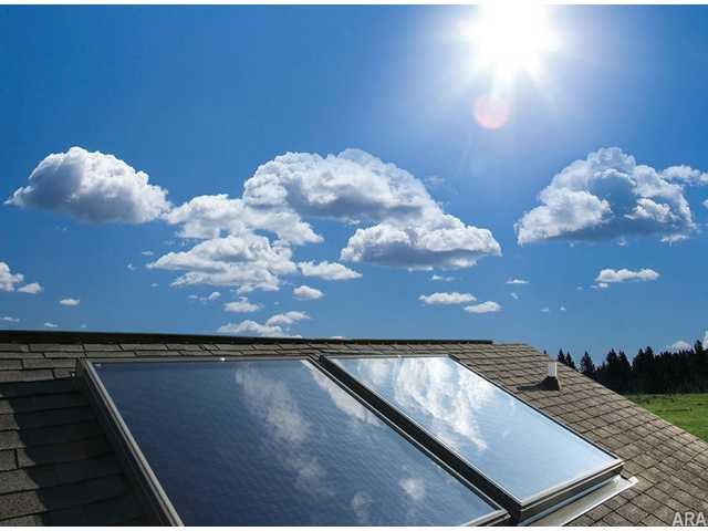 Low-profile solar collectors, which look like skylights, blend well with rooflines. Solar power is gaining broad acceptance across the country as a cost-effective way to reduce utility costs.
