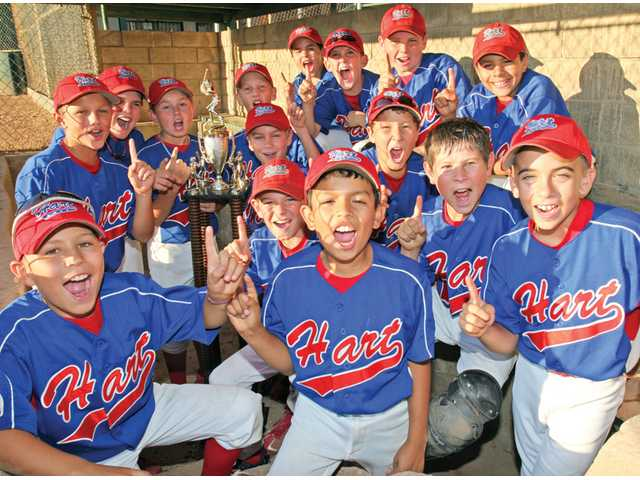 The William S. Hart PONY League Mustang All-Stars pose on Wednesday with the trophy they were awarded for winning the Mustang World Series.